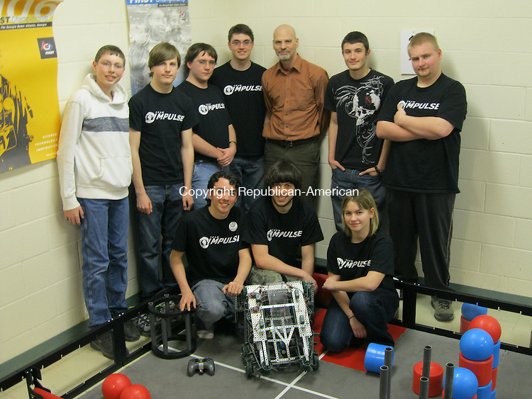 BEACON FALLS, CT - 09 March 2012 - 030912QL02 - Members of the robotics team at Woodland Regional High School in Beacon Falls pose with their robot that they will take to the world robotics competition in Anaheim, Calif., next month. Team Impulse, which is comprised of all seniors except one freshman, is: (from left to right in back) Ryan Leeper, 15, a freshman; Jacob Hawes, 17; Alex Smith, 17; Dan Lyons, 18; Mark Mierzejewski, a physics and astronomy teacher at the school; Jerry Zollo, 17; and Chris Bailey, 18. In front from left to right: Arty Kica, 17; Zach Blum, 18; and Marianna Majewska, 17. Quannah Leonard Republican-American