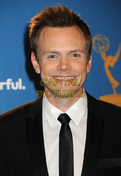 JOEL McHALE.62nd Annual Primetime Emmy Awards held at NOKIA Theatre Los Angeles, California, USA. .29th August 2010.headshot portrait tie smiling black white .CAP/ADM/BP.©Byron Purvis/AdMedia/Capital Pictures.