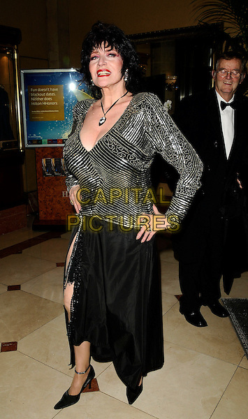 FAITH BROWN .Inside Arrivals - The Spirit of Cuba Ball, .London Hilton Park Lane Hotel, London, England, November 15th 2008..full  length silver top black skirt slit thigh split posing necklace sequined ankle strap shoes hands on hips .CAP/CAN.©Can Nguyen/Capital Pictures