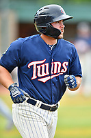 Elizabethton Twins designated hitter Charlie Mack (27) walks to first base during a game against the Kingsport Mets at Joe O'Brien Field on July 6, 2019 in Elizabethton, Tennessee. The Twins defeated the Mets 5-3. (Tony Farlow/Four Seam Images)