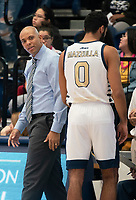 WASHINGTON, DC - NOVEMBER 16: Coach Jamion Christian of George Washington talks to Justin Mazzulla #0 of George Washington during a game between Morgan State University and George Washington University at The Smith Center on November 16, 2019 in Washington, DC.