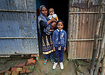 Rehena Akter poses with two of her children in Suihari in northern Bangladesh. Devastating floods in August 2017 affected thousands of families across the region, and Akter and her family lost their home. Today they live with a neighbor, and she's hopeful she can soon borrow the money from a local savings group in order to start construction of her own home.<br /> <br /> While families in the area were still displaced by high waters, Christian Aid and the Christian Commission for Development Bangladesh, both members of the ACT Alliance, worked together to provide emergency food packages to vulnerable residents, including Akter and her family.