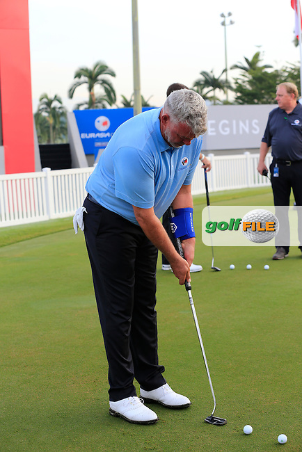 European Team Captain Darren Clarke (NIR) brushes up on his putting skills before Pro-Am Day of the 2016 Eurasia Cup held at the Glenmarie Golf &amp; Country Club, Kuala Lumpur, Malaysia. 14th January 2016.<br /> Picture: Eoin Clarke | Golffile<br /> <br /> <br /> <br /> All photos usage must carry mandatory copyright credit (&copy; Golffile | Eoin Clarke)