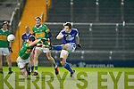 John Mitchels Ciaran Deane tries to block Kerins O'Rahilly's David Moran shot in the John Kissane memorial cup final at Austin Stack park, Tralee on Saturday.