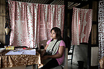 Kherinda 29, preaparing to cook a Dinner in her bamboo house in the middle of the Village.<br />