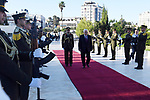 Palestinian President Mahmoud Abbas lays a wreath on the grave of late Palestinian leader Yasser Arafat on the first day of Eid al-Fitr in the West Bank city of Ramallah on June 15, 2018. Muslims worldwide celebrate Eid al-Fitr marking the end of the fasting month of Ramadan. Photo by Thaer Ganaim