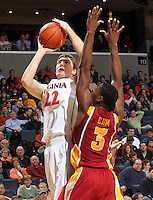Dec. 30, 2010; Charlottesville, VA, USA; Virginia Cavaliers forward Will Sherrill (22) shoots over Iowa State Cyclones forward Melvin Ejim (3) during the game at the John Paul Jones Arena. Iowa State Cyclones won 60-47. Mandatory Credit: Andrew Shurtleff-