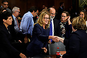 Christine Blasey Ford shakes hands with Phoenix prosecutor Rachel Mitchell as she finished testifying before the Senate Judiciary Committee on Capitol Hill in Washington, Thursday, Sept. 27, 2018. (AP Photo/Andrew Harnik, Pool)