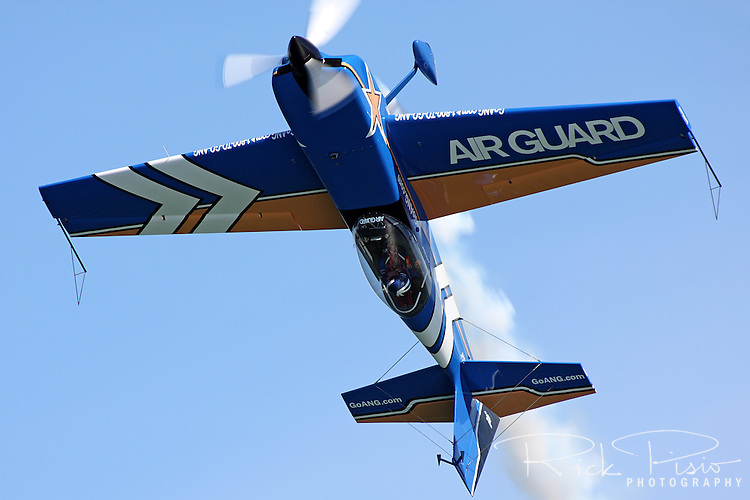 John Klatt flies inverted in his custom built Staudacher S-300D during the 2010 San Francisco Fleet Week Air Show. The Staudacher S-300D weighs only 1250 pounds and is powered by a Lycoming A10-540 that delivers more than 330 HP.