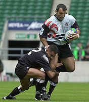 24/05/2002 (Friday).Sport -Rugby Union - London Sevens.New Zealand vs Georgia.Geogia's Besik Khamasuridze, tackled by Eric Rush[Mandatory Credit, Peter Spurier/ Intersport Images].