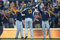 Jackson Cramer (13) of the West Virginia Mountaineers is greeted at home plate by teammates Kyle Davis (right) and Darius Hill (left) after hitting a 2-run home run against the Wake Forest Demon Deacons in Game Four of the Winston-Salem Regional in the 2017 College World Series at David F. Couch Ballpark on June 3, 2017 in Winston-Salem, North Carolina. The Demon Deacons walked-off the Mountaineers 4-3. (Brian Westerholt/Four Seam Images)