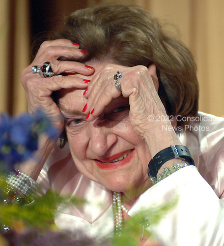 Long-time White House journalist Helen Thomas laughs at a skit during the White House Correspondents' Association Dinner in Washington on April 29, 2006.    (UPI Photo/Roger L. Wollenberg)..