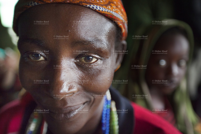 Ethiopia. Southern Nations, Nationalities, and Peoples' Region. Karat village. Konso tribe. Portrait of a smiling Konso woman. The Konso, also known as the Konzo, are a Cushitic-speaking ethnic group. They are agriculturists. Although the Konso people have many customs dating back hundreds of years, it is not uncommon for them to be seen wearing western clothing. The Omo Valley, situated in Africa's Great Rift Valley, is home to an estimated 250,000 individuals of the Konso tribe. Southern Nations, Nationalities, and Peoples' Region (often abbreviated as SNNPR) is one of the nine ethnic divisions of Ethiopia 7.11.15 © 2015 Didier Ruef