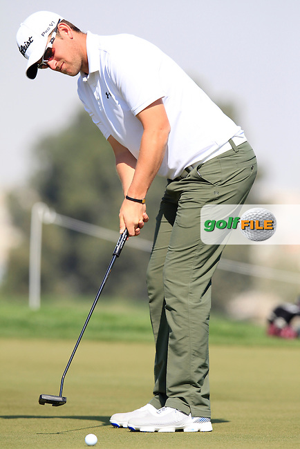 Bernd WIESBERGER (AUT) putts on the 5th green during Thursday's Round 2 of the 2015 Commercial Bank Qatar Masters held at Doha Golf Club, Doha, Qatar.: Picture Eoin Clarke, www.golffile.ie: 1/22/2015