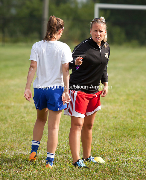 BEACON FALLS, CT-26 August 2014-082214BF05- Woodland Regional High School girls soccer coach Cait Witham talks to player Rosalina Santos as they prepare for the season during practice Tuesday morning at the school in Beacon Falls.  Bob Falcetti Republican-American