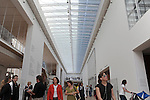 """Visitors are seen in the atrium of the recently unveiled Modern Wing of the Art Institute Chicago, designed by architect Renzo Piano on the first """"free Tuesday"""" where admission costs nothing and is open to the public, in Chicago, Illinois on May 19, 2009."""