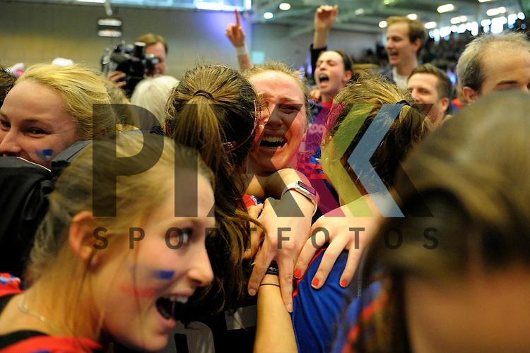GER - Luebeck, Germany, February 07: Players of Mannheimer HC celebrate after winning the Deutsche Meistertitel in the final of the 1. Bundesliga Damen indoor hockey final match at the Final 4 between Mannheimer HC (blue) and Duesseldorfer HC (white) on February 7, 2016 at Hansehalle Luebeck in Luebeck, Germany. Final score 6-4 after shootout. <br /> <br /> Foto &copy; PIX-Sportfotos *** Foto ist honorarpflichtig! *** Auf Anfrage in hoeherer Qualitaet/Aufloesung. Belegexemplar erbeten. Veroeffentlichung ausschliesslich fuer journalistisch-publizistische Zwecke. For editorial use only.