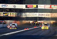 Nov 8, 2013; Pomona, CA, USA; NHRA funny car driver Bob Bode (right) races alongside Tim Wilkerson during qualifying for the Auto Club Finals at Auto Club Raceway at Pomona. Mandatory Credit: Mark J. Rebilas-