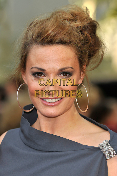 "SARAH PARISH.Attending the ""Sex And The City 2"" UK film premiere, Odeon Leicester Square, London, England, UK..May 27th 2010.arrivals headshot portrait smiling silver hoop earrings grey gray buckle.CAP/PL.©Phil Loftus/Capital Pictures."