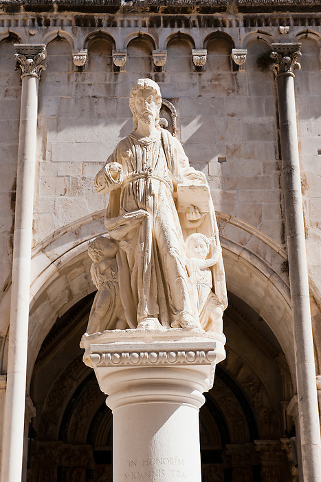 Photo of the statue of St Lawrence, St Lawrence Square, Trogir, Dalmatian Coast, Croatia, Europe. This photo shows the statue of St Lawrence, located outside St Lawrence Cathedral in St lawrence Square, Trogir. Trogir is a beautiful old town on the Dalmatian Coast of Croatia and is on the UNESCO World Heritage List thanks to it's stunning Romanesque Cathedral's and architecture.