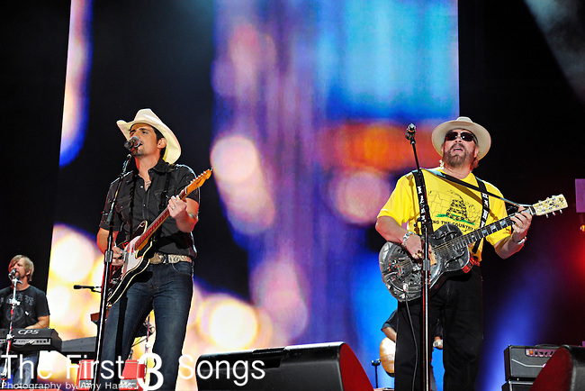 Brad Paisley performs with Hank Williams Jr. at LP Field during the 2012 CMA Music Festival on June 07, 2011 in Nashville, Tennessee.