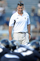 17 September 2011:  FIU Football Head Coach Mario Cristobal watches as his players run through drills prior to the game.  The FIU Golden Panthers defeated the University of Central Florida Golden Knights, 17-10, at FIU Stadium in Miami, Florida.