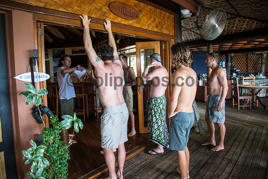Namotu Island Resort, Fiji. Thursday February 5 2015) - The surf was still in the 2' range for most of the day with the guests splitting themselves between surfing at Despos and fishing before the running of the Monkey Man Triathlon.  The Triathlon included beer drinking darts, SUPing around the island , laps of the pool, push ups and a swim and dive.  Photo: joliphotos.com