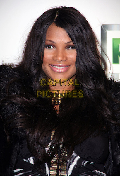 "SANDRA ""PEPA"" DENTON.The series premiere party for 'Running Russell Simmons' at Lavo on  in New York City, NY, USA..October 19th, 2010.headshot portrait black feathers pink lipstick make-up beauty .CAP/ADM/PZ.©Paul Zimmerman/AdMedia/Capital Pictures."
