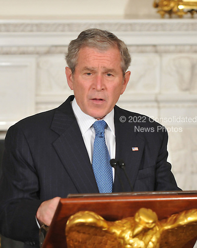 Washington, D.C. - November 14, 2008 -- United States President George W. Bush makes remarks in the State Dining Room of the White House to the Summit on Financial Markets and the World Economy on the North Portico of the White House in Washington, D.C. on Friday, November 14, 2008..Credit: Ron Sachs / Pool via CNP