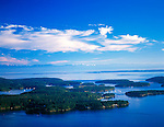San Juan County, WA<br /> Roche Harbor on San Juan Island from above the Spieden Channel, Olympic range in the distance