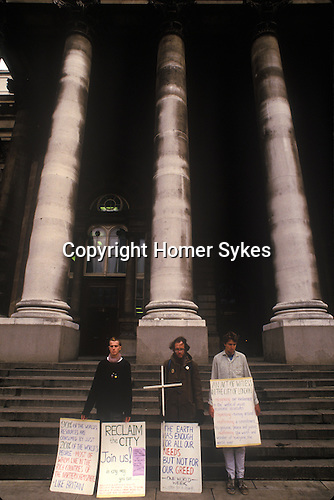 Reclaim the City demonstration 1980s. Demonstration against capitalism City of London England. 1984. Police search man outside the Bank of England.