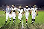 Lawndale, CA 10/21/11 - Tommy Webster (Peninsula #49), Alejandro Garcia (Peninsula #84), Ken Martin (Peninsula #22), Joey Augello (Peninsula #58) in action during the Peninsula - Leuzinger varsity football game.