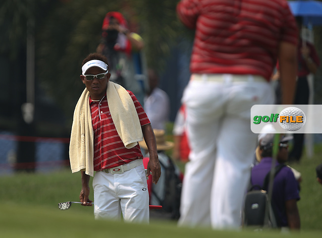 Team Asia Captain, Thongchai Jaidee (THA) looks again at the line of putt on the 9th during the second day Foursome matches at the 2014 EurAsia Cup presented by DRB-Hicom, at the Glenmarie Golf & Country Club, Kuala Lumpur, Malaysia. Picture:  David Lloyd / www.golffile.ie