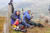 Plane spotters have a coffee break as they wait for airplanes. The 'Mach Loop' is the nick name of an area in Wales used for low flying by the Royal Air Force. The proximity to the aircraft has made the area popular with plane spotters who come to see and photograph the aircraft.