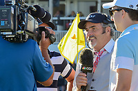 David Feherty waits to interview Rickie Fowler on 14 after  round 4 Singles of the 2017 President's Cup, Liberty National Golf Club, Jersey City, New Jersey, USA. 10/1/2017. <br /> Picture: Golffile | Ken Murray<br /> <br /> All photo usage must carry mandatory copyright credit (&copy; Golffile | Ken Murray)