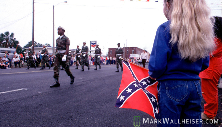 A young girl watches a African-American R.O.T.C. unit march during a downtown parade in Cairo, GA.