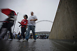 Swansea fans making their way from the stadium in the rain after the Npower Championship play-off final between Reading (blue) and Swansea City at Wembley Stadium. The match was won by Swansea by 4 goals to 2 watched by a crowd of 86,581. Swansea became the first Welsh team to reach the top division of English football since they themselves played there in 1983.
