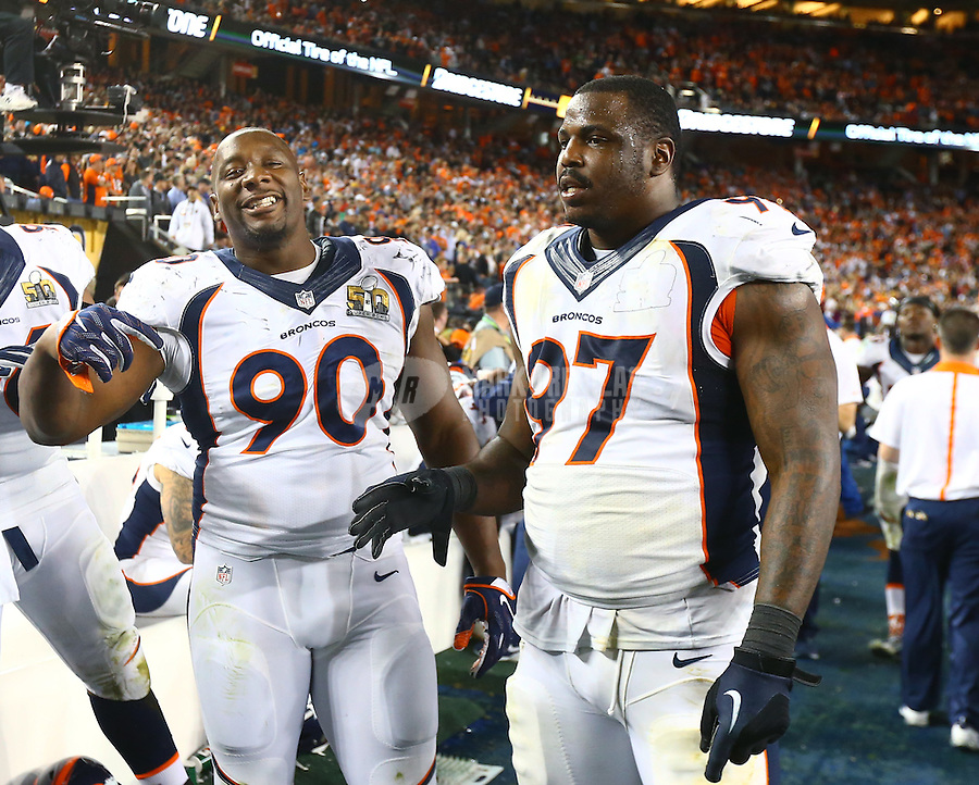 Feb 7, 2016; Santa Clara, CA, USA; Denver Broncos defensive tackle Malik Jackson (97) and defensive end Antonio Smith (90) celebrate in the closing minutes of the game against the Carolina Panthers in Super Bowl 50 at Levi's Stadium. Mandatory Credit: Mark J. Rebilas-USA TODAY Sports