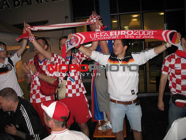 Supporters of Croatia and Germany together drinking in Klagenfurt, Austria. June 11, 2008 Photo by Sanjin Strukic/24sata /  nph (  nordphoto  )