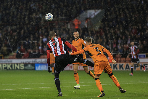 27th September 2017, Bramall Lane, Sheffield, England; EFL Championship football, Sheffield United versus Wolverhampton Wanderers; Leon Clarke of Sheffield United heads the ball while under pressure from Barry Douglas of Wolverhampton Wanderers FC
