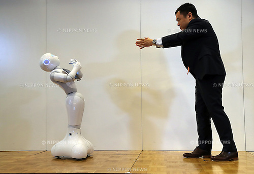 "May 19, 2016, Tokyo, Japan - Japanese telecom giant Softbank's humanoid robot Pepper (L) demonstrates Google's Android application with Softbank Robotics executive Kazutaka Hasumi at a press conference at the Softbank headquarters in Tokyo on Thursday, May 19, 2016. Pepper will support Google's Android OS, and that presales of models for developers will begin from July 2016. And SoftBank will offer a software development kit ""Pepper SDK for Android Studio"" which enables the development of RoboApps on the Android platform.  (Photo by Yoshio Tsunoda/AFLO) LWX -ytd-"