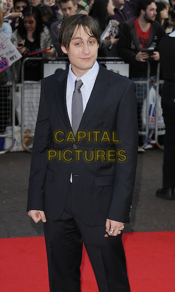 KIERAN CULKIN .The UK premiere of 'Scott Pilgrim Vs. The World' held at the Empire cinema, Leicester Square, London, England..18th August 2010.Arrivals half length black suit tie .CAP/CAN.©Can Nguyen/Capital Pictures.
