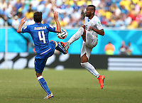 Alvaro Pereira of Uruguay and Matteo Darmian of Italy in action
