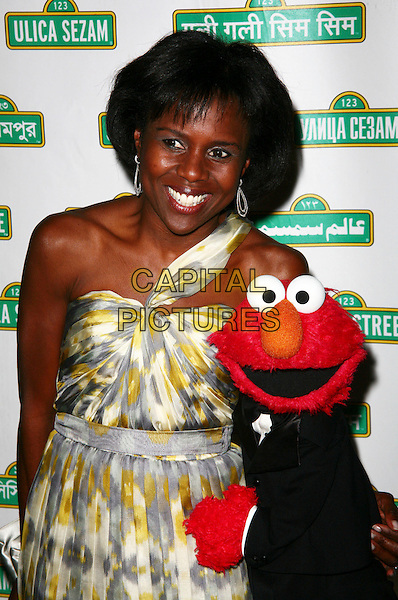 DEBORAH ROBERTS & ELMO.Sesame Workshop's 8th Annual Benefit Gala at Cipriani 42nd Street, New York City, NY, USA..June 2nd, 2010.half length white dress yellow grey gray one shoulder muppet.CAP/ADM/PZ.©Paul Zimmerman/AdMedia/Capital Pictures.