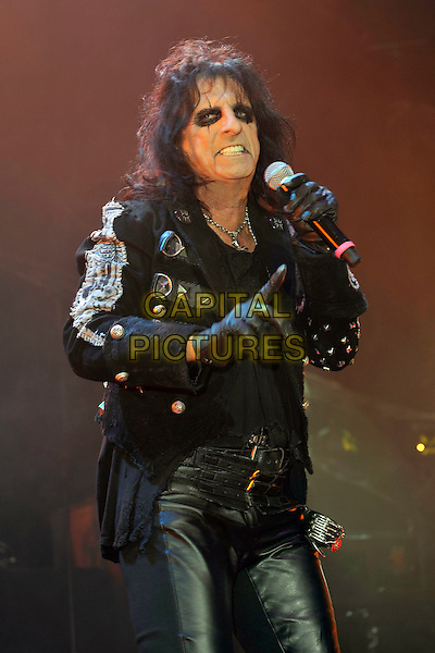 ALICE COOPER.performs live during the first night of Alice Cooper's Halloween Night of Fear 2010, the Roundhouse, Camden, London, England, UK, .31st October 2010..gig concert music  on stage half length black eyeliner make-up silver studded jacket gloves leather trousers singing microphone .CAP/MAR.© Martin Harris/Capital Pictures.