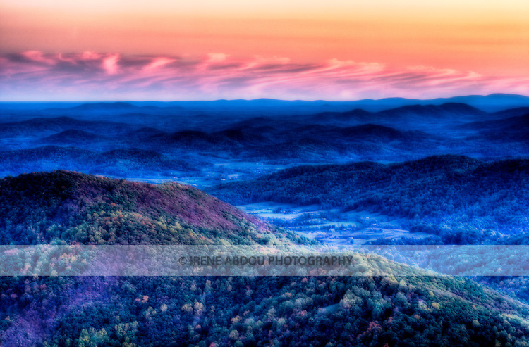 The full glory of an autumn sunset over a scenic expanse of the Blue Ridge Mountains in Shenandoah National Park, Virginia is captured through high-dynamic range imaging.