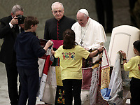 "Pope Francis receives a present during an audience with members of the ""Yo Puedo!"" project in the Paul VI hall at the Vatican on November  30, 2019.<br /> UPDATE IMAGES PRESS/Isabella Bonotto<br /> <br /> STRICTLY ONLY FOR EDITORIAL USE"