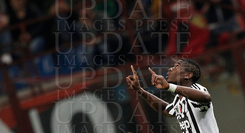 Calcio, Serie A: Milan vs Juventus. Milano, stadio San Siro, 9 aprile 2016. <br /> Juventus&rsquo; Paul Pogba celebrates after scoring the winning goal during the Italian Serie A football match between AC Milan and Juventus at Milan's San Siro stadium, 9 April 2016. Juventus won 2-1.<br /> UPDATE IMAGES PRESS/Isabella Bonotto
