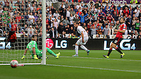 Pictured: Gylfi SIgurdsson of Swansea (C) shows his frustration after his shot scraped off the post Sunday 30 August 2015<br />