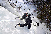 Cst. Kevin Brown of the Ottawa Police Services tactical unit takes part in an ice climbing exercise as part of green ops training in Calabogie, Ont., on Monday, Jan. 30, 2017. The Canadian Press/Sean Kilpatrick